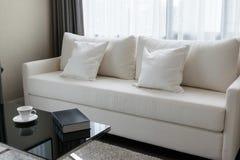 White decorative pillows on a casual sofa Stock Photo