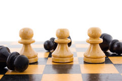 White defeats black. Chess concept, white defeats black Royalty Free Stock Image