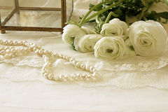 White delicate lace fabric and flowers Stock Photos