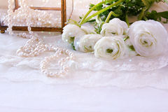 White delicate lace fabric and flowers Stock Images