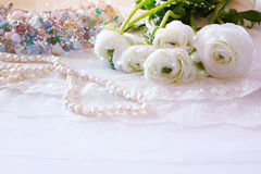 White delicate lace fabric and white flowers Royalty Free Stock Images