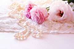 White delicate lace fabric and white flowers Stock Images