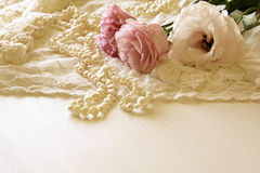 White delicate lace fabric and white flowers Stock Image