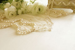 White delicate lace fabric and white flowers Royalty Free Stock Photo