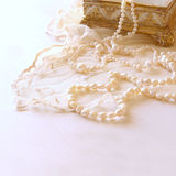 White delicate lace fabric and white pearls Royalty Free Stock Images