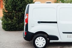 White delivery mini truck stands near building Stock Photos
