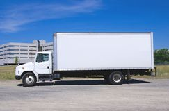 White Delivery Truck. This is a picture of a typical six wheel city delivery cargo vehicle with a blank white van box Royalty Free Stock Images