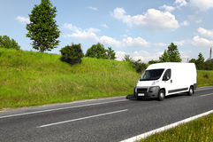 White delivery van. On highway Royalty Free Stock Image