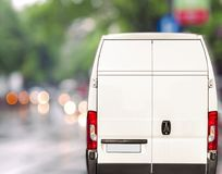White delivery Van driving fast on city blurr bokeh street Stock Image