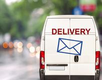 White delivery Van driving fast on city blurr bokeh street Stock Photos
