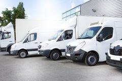 White delivery vans truck on parking in front on the entrance a warehouse at distribution van Royalty Free Stock Photos