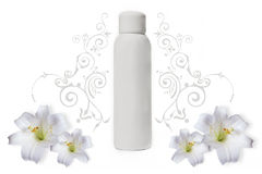 White deodorant. Bottle with white flowers and floral ornaments Stock Photo