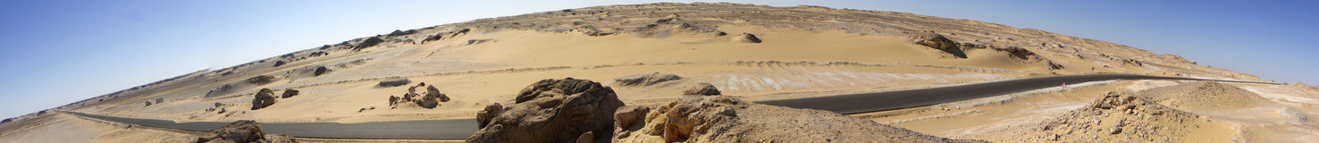 White desert mountains panorama with a road running to the horizon Royalty Free Stock Photo