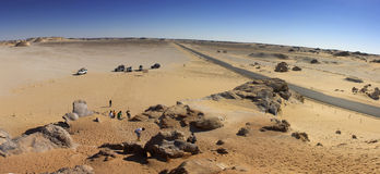 White desert mountains panorama with a road running to the horizon. Road located in the white desert next to the Crystal rock, Oasis region, Egypt Stock Photos