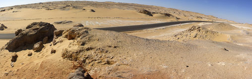 White desert mountains panorama with a road running to the horizon Stock Photography