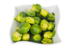 White designer bowl with fresh green brussels sprout. Isolated on white Royalty Free Stock Photos