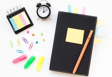 Notepad with sticky note. stock photography