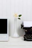 White Desk Closeup with Bud Vase Stock Image