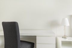 White desk and gray chair stock photos