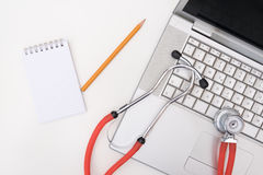 White desk medical stethoscope on a laptop Royalty Free Stock Photos