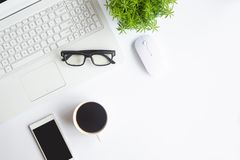 White desk office with laptop, smartphone and other work supplies with cup of coffee. Top view with copy space for input the text. Designer workspace on desk royalty free stock photo