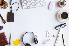 White desk office with laptop, smartphone and other work supplies with cup of coffee. Top view with copy space for input the text. Designer workspace on desk royalty free stock photography