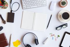 White desk office with laptop, smartphone and other work supplies with cup of coffee. Top view with copy space for input the text. Designer workspace on desk royalty free stock photos
