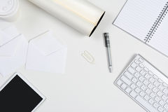 White Desk With Tablet and Keyboard Stock Photo