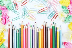 White desk top with colorful supplies. Top view of white office desk top with colorful supplies. Art, school and design concept Stock Image