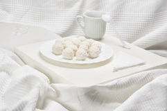 White dessert. White tray with dessert on the bed royalty free stock images