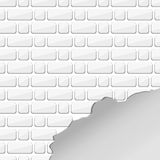 White destroyed brick wall. Uneven edge. Chipped bricks. Texture of bricks. Royalty Free Stock Photo
