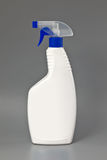White detergent plastic spray bottle Isolated on gray Stock Image
