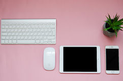 White devices on pink background. mock up stock photography