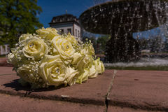 White Diamond Rose Bouqet Flowers at Fountain Outdoors Wedding. White Diamond Rose Bouqet Flowers at Fountain Outdoors royalty free stock photo