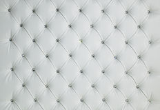 WHITE DIAMOND STUDDED PADDED LUXURY LEATHER BACKGROUND Stock Images