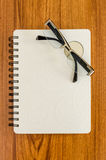 White diary and black glasses Stock Image