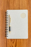 White diary and gold pen Stock Images