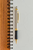 White diary and gold pen Royalty Free Stock Image