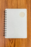 White diary on wood table Stock Photography