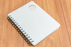 White diary on wood table Royalty Free Stock Image