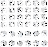 White Dice. Various white dice with black spots. Each face represented, plus rolling dice Royalty Free Stock Photos