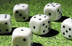 White dice. Dice by playing on green table Royalty Free Stock Photos
