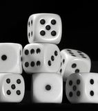 White dice in black back Stock Photography