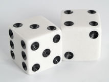 White Dice Black Dots. Two white dice with dots colored in black Stock Photography