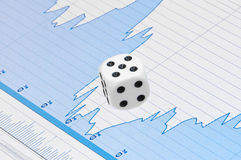 White dice on digital screen with financial chart Royalty Free Stock Images