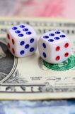 White dice are on a dollar bill of US dollars. The concept of gambling with rates in monetary unit. S stock photography
