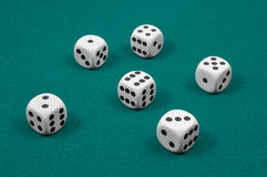 White dice on green felt Stock Image