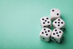 White dice on green table. Gambling devices. Copy space for text. Game of chance concept. Royalty Free Stock Image