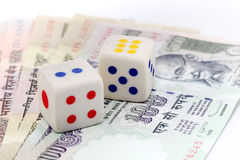 White dice on Indian currency notes. Two white dice on Indian currency notes Royalty Free Stock Image