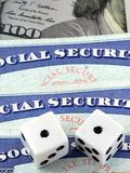 White Dice Laying on Social Security Card Stock Photo